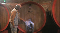 Italy Barolo man and red ring wine barrel  - stock footage