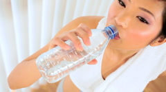 Asian Girl With Drinking Water After Gym Workout Stock Footage