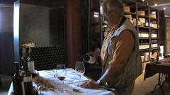 Italy Barbaresco Sid in cellar looking at wine Stock Footage