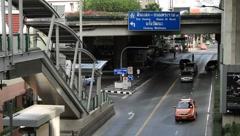 Urban busy traffic around Soi Ruam Ruedi in downtown Bangkok Stock Footage