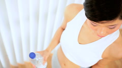 Asian Girl with Water After Workout Stock Footage