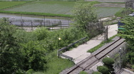 Stock Video Footage of DMZ Panmunjon North Korean border rice fields and train passing by