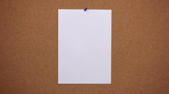 HD: a sheet of paper on the pinboard.  Stock Footage