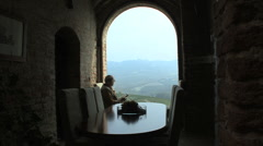 Italy Grinzane Cavour man enoteca view Stock Footage