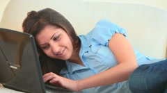 Stock Video Footage of Young woman amusing herself  with her laptop