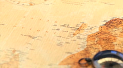 Worldmap and a compass rotating Stock Footage