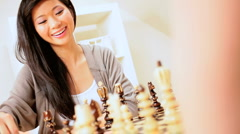 Beautiful Asian Girl Playing Chess Stock Footage
