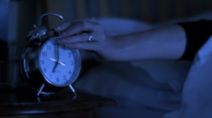 Woman woken up by alarm clock Stock Footage