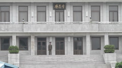 DMZ Panmunjon North Korean soldier walking in front of building Stock Footage