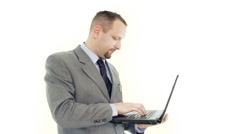 Businessman working on laptop, isolated on white Stock Footage