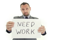 Unhappy businessman holding paper sheet with NEED WORK, isolated on whiteNTSC Stock Footage