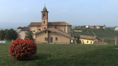 Italy Barolo Grinzane Cavour church and red bush Stock Footage