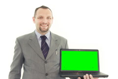 Businessman presenting laptop with green screen and tracking points Stock Footage