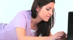Stock Video Footage of Young woman amusing herself on her laptop