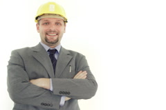 Handsome happy male engineer in helmet with crossed hands portrait, isolated Stock Footage