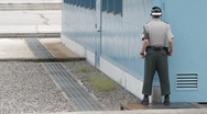 DMZ Panmunjon North Korean border United Nation Soldier large shot Stock Footage