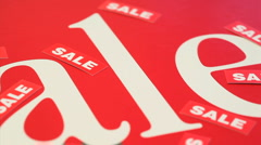 "Word ""Sale"" written in white turning Stock Footage"