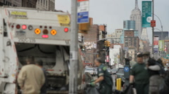 Sanitation Garbage Truck Workers in Manhattan New York City Empire State NYC Stock Footage
