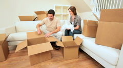 Couple Unpacking Moving Cartons Stock Footage