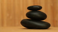 Pile of black pebbles rotating Stock Footage