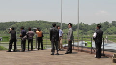 DMZ Panmunjon North Korean border  tourist group at sight seeing spot Stock Footage