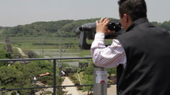 DMZ Panmunjon North Korean border tourist at sight seeing spot Stock Footage