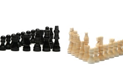 White chess pieces in front of black chess pieces Stock Footage
