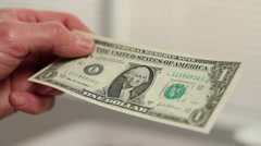 Dollar bill cut in half Stock Footage