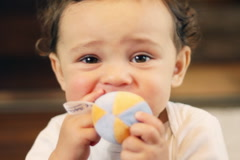Happy baby boy playing with ball toy Stock Footage