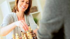 Female Winning Chess Game with Husband - stock footage