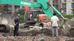 China demolition construction excavators machinery workers changing city Stock Footage