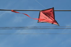 Kite stuck in wires. 2 shots. SD. Stock Footage