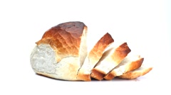 Sliced round white bread loaf rotating Stock Footage