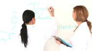 Scientist women writing a formula Stock Footage