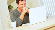 Young Male at Home Using Laptop Stock Footage