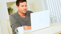 Relaxed Young Male Using Internet Webchat - stock footage