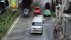Bangkok downtown traffic with cars and Tuk-tuk Stock Footage
