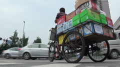 China worker income gap poverty goods transport bicycle delivery Stock Footage