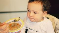 Mother feeding little baby boy HD Stock Footage
