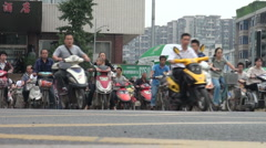 Motorbikes and (electrical) bicycles in Chinese city Stock Footage
