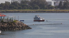 Long Beach Harbor cabin cruiser heading out Stock Footage
