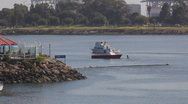 Stock Video Footage of Long Beach Harbor cabin cruiser heading out