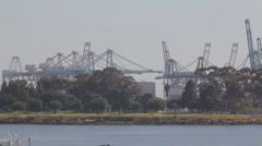 Port of Long Beach shipyard container cranes - telephoto - pans - stock footage