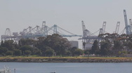 Stock Video Footage of Port of Long Beach shipyard container cranes - telephoto - pans