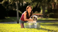 Caucasian Female Bathing Her Pet Bulldog Stock Footage