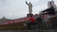 Stock Video Footage of Mao statue and contemporary traffic, old and new China