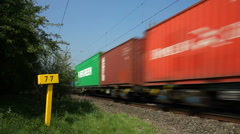Electric locomotive hauled container freight train, Northamptonshire England UK Stock Footage