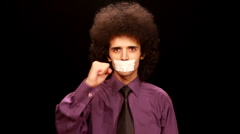 Young man sticking paper on his mouth Stock Footage