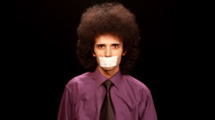 Young man sticking paper on his mouth 2 Stock Footage