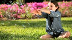 Female Child in Garden with Play Bubbles Stock Footage